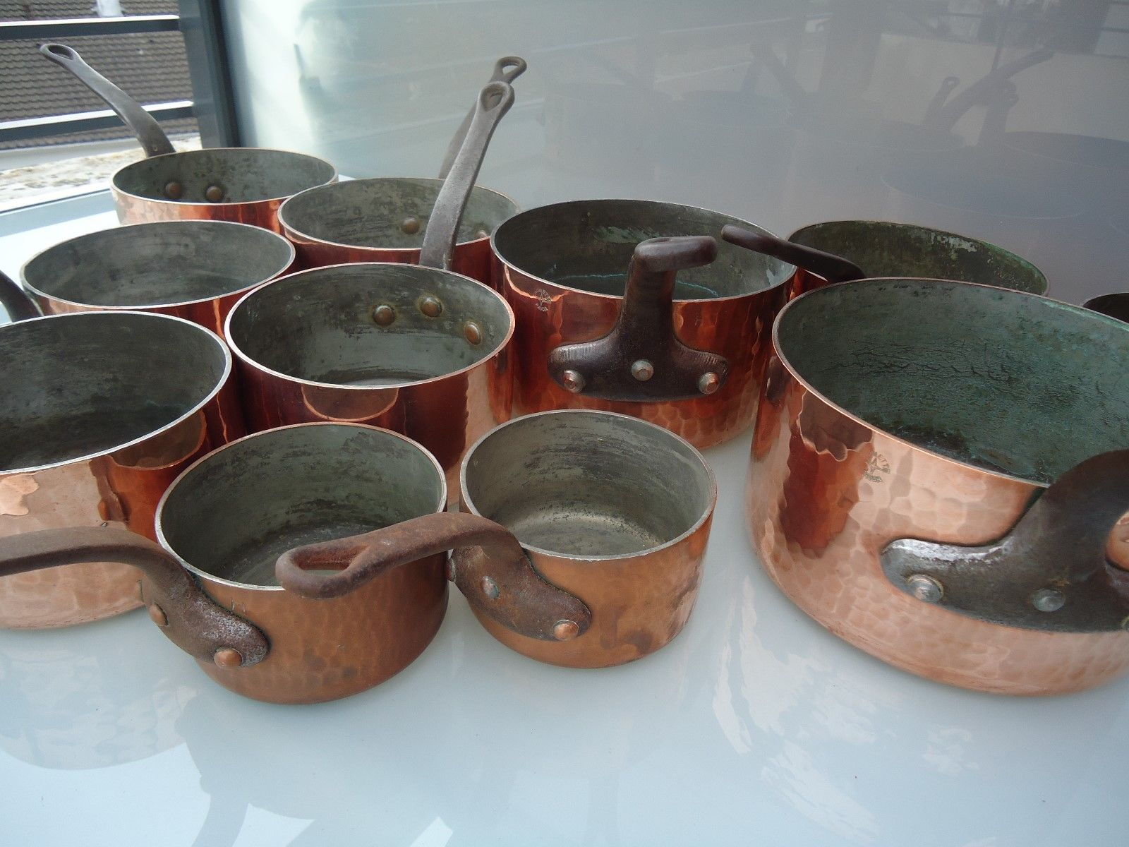 Retinning of Extra-Fort pots and pans.